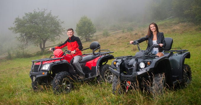 Young couple on their ATVs