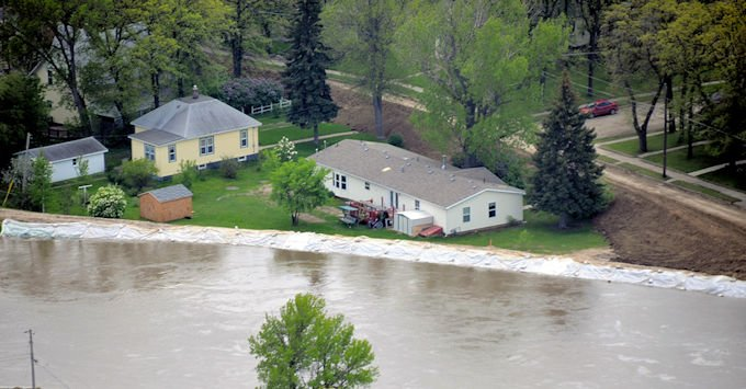 Homes threatened by flood waters
